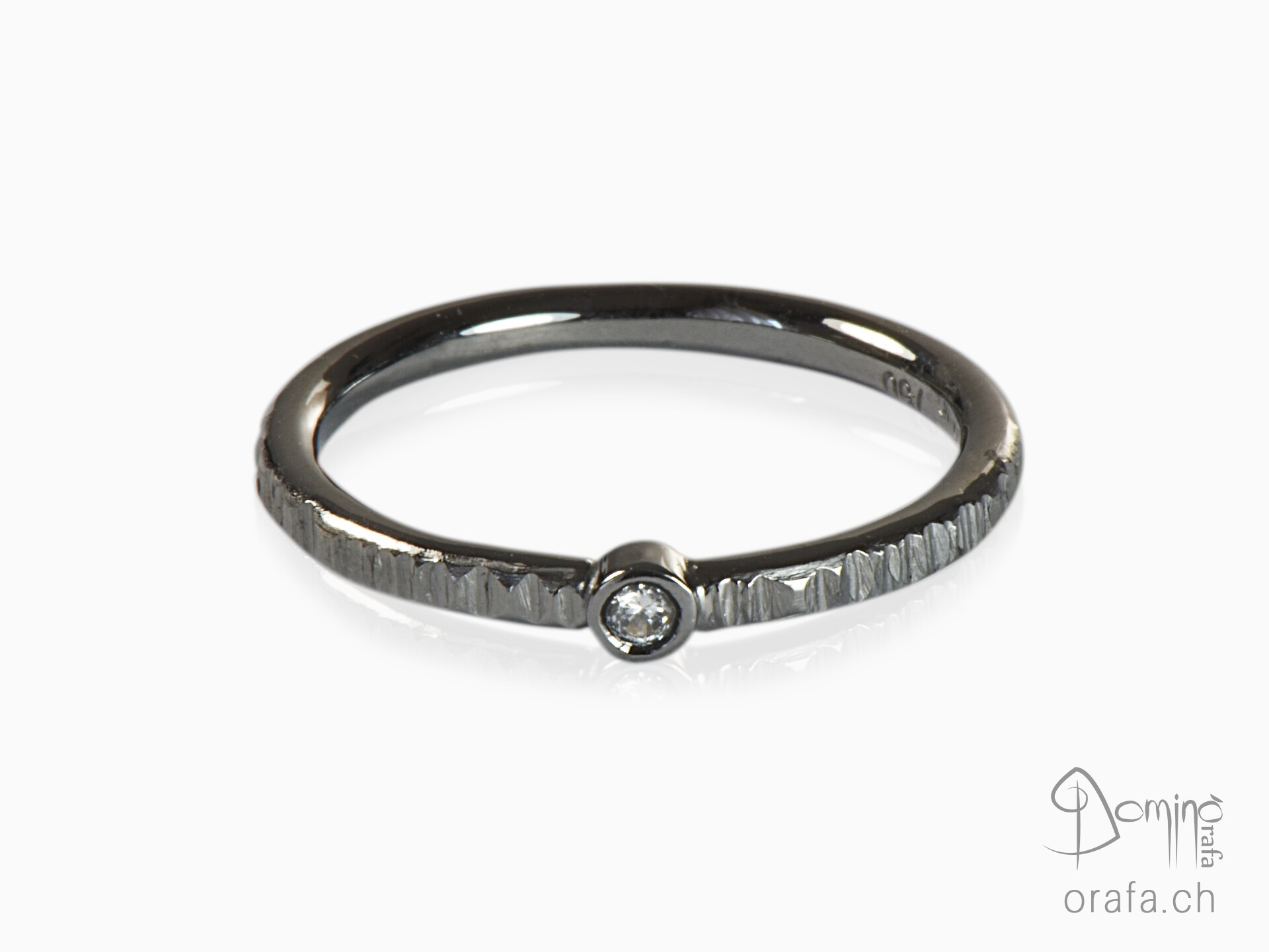 Black rhodiated ring with diamond