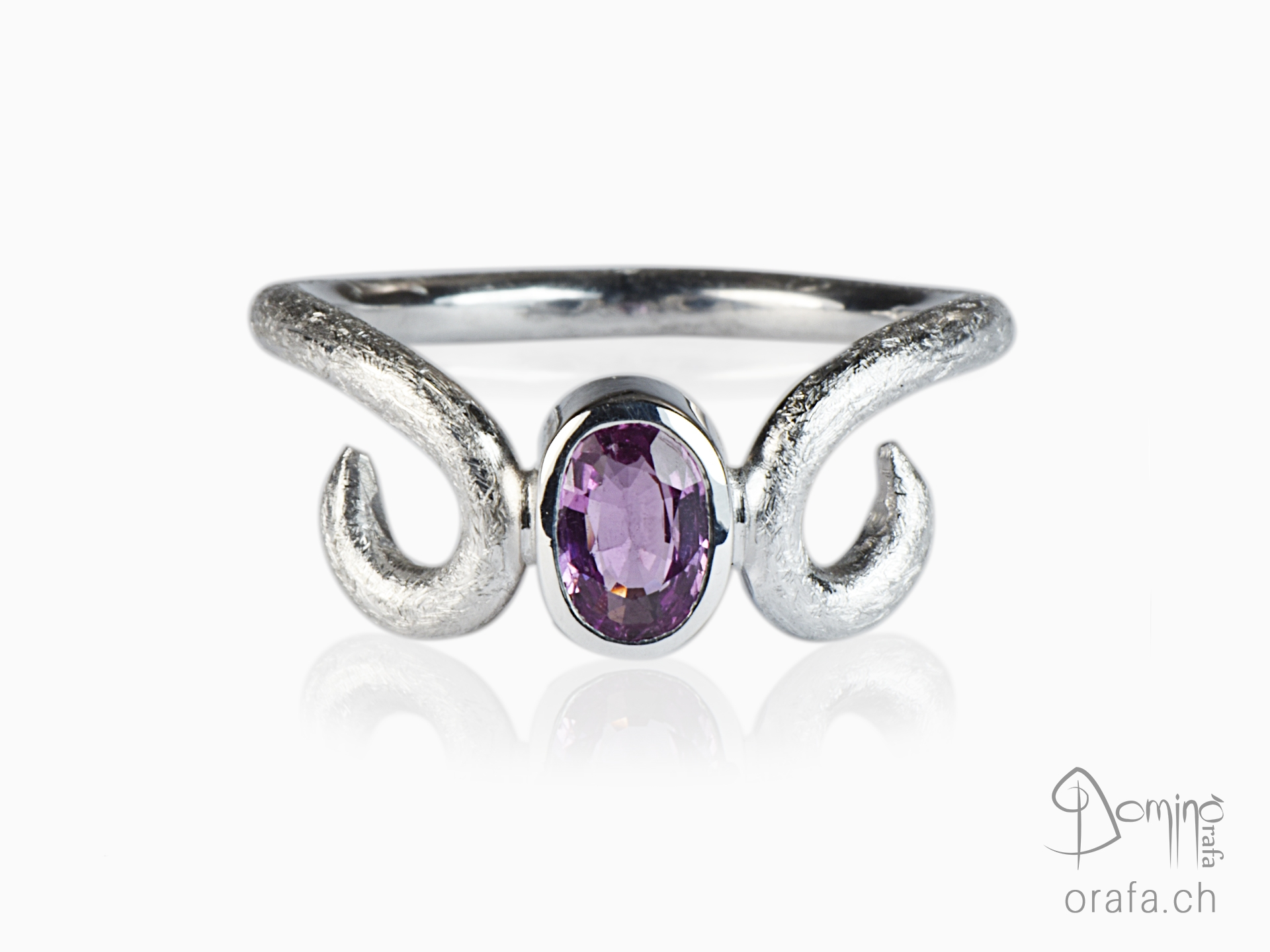 White gold ring with pink sapphire
