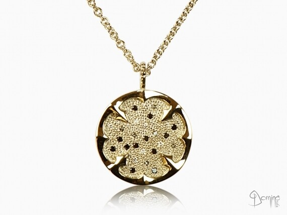 ciondolo-quadrifoglio-diamanti-incolore-grig-neri-oro-giallo