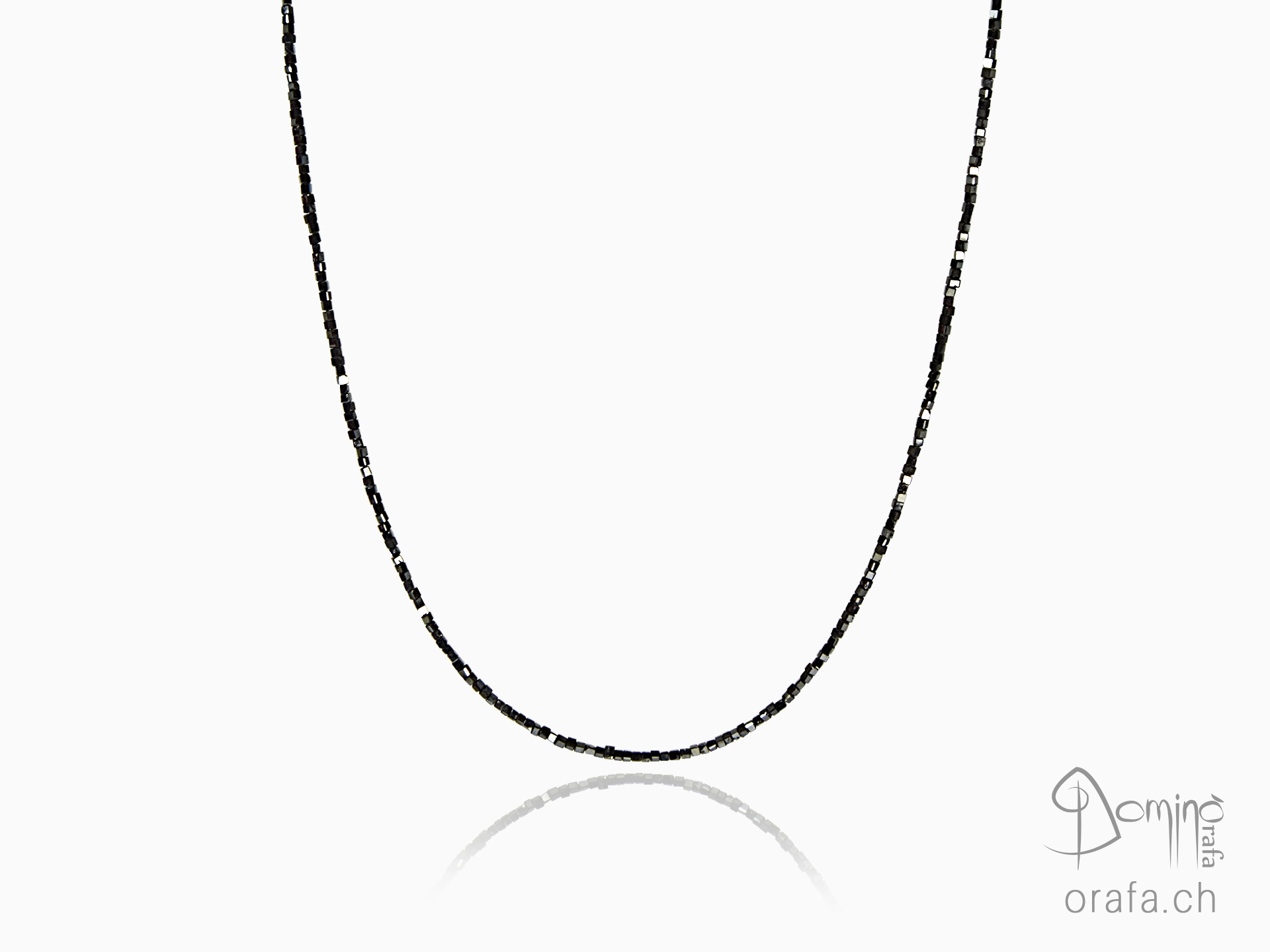 Black diamonds and gold necklace