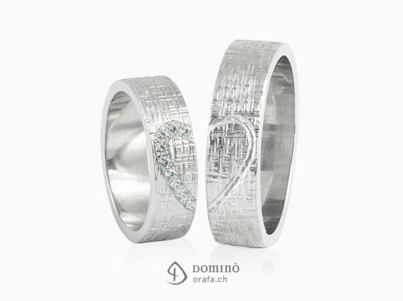 fedi-nuziali-linee-incrociate-contorno-cuore-diamanti-incisione-oro-bianco