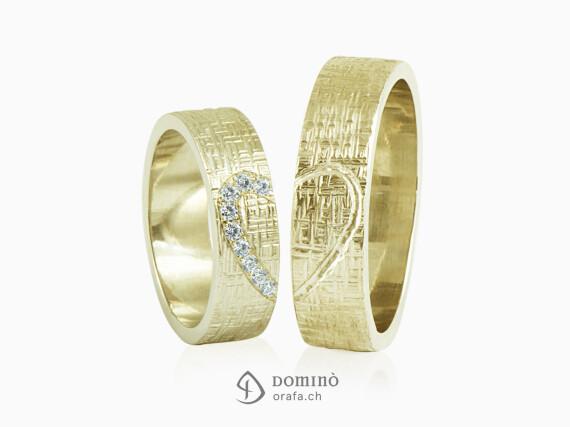 fedi-nuziali-linee-incrociate-contorno-cuore-diamanti-incisione-oro-giallo