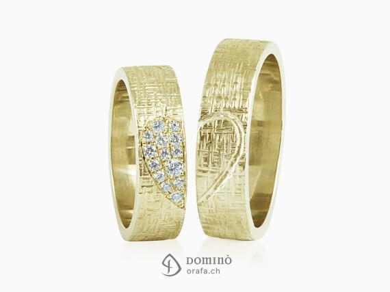 fedi-nuziali-linee-incrociate-cuore-diamanti-inciso-oro-giallo